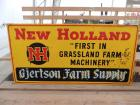 "New Holland ""First in Grassland Farm Machinery"" SST sign"