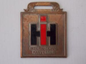 International Harvester enameled Fob