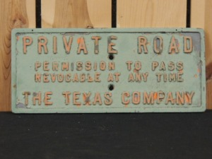 The Texas Company Private Road embossed cast iron sign