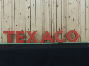 Texaco red plastic sign letters mounted on board