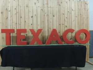 Texaco red porcelain letters mounted on board