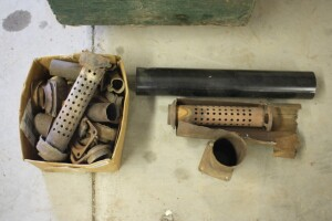 assorted used muffler parts for rebuilding