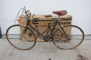 New John Deere Black mens 21inch bike still has the original box