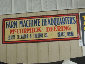 McCormick-Deering Farm Machine Headquarters single sided heavy cardboard sign w/light metal frame