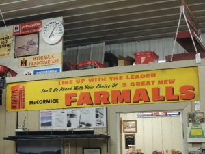 "McCormick Farmalls ""Line Up with the Leader"" heavy paper banner"