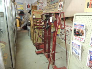 International Harvester Sweeps, Shovels, & Steels display rack w/few sweeps included