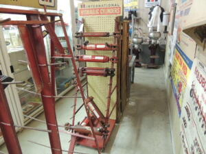 International Hydraulic Cylinders display rack w/7-cylinders
