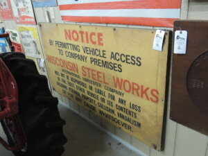 "Wisconsin Steel Works-International Harvester Company ""Notice"" single sided fiberglas sign mounted on wood"