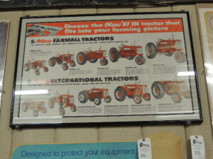 """Choose the New '57 IH tractor that fits into your farming picture"" framed paper advertisement"