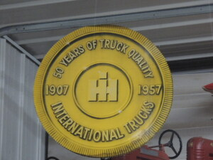 1957 International Trucks cardboard medallion dealer display