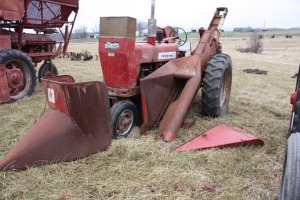 Farmall 450 with mounted 2 row corn picker