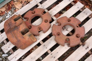 pair of Farmall front wheel weights and utility nose weight