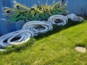 "Large Lot of 4"" Black and White Drainage Tubing."