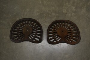 Pair of Deering Cast Iron Seats