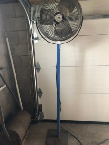 Garage fan with stand