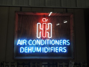 IH Air Conditioners Dehumidifiers neon lettering in wooden box