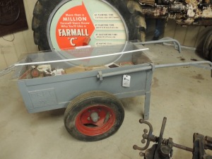 Pull cart display w/plastic cover and Dept. IX weld to rear