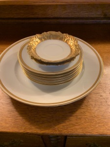 Set of china including 6 saucers, 4  tea cups. Gold rims.