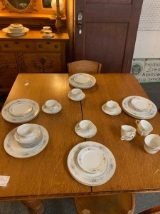Dishware set made in Japan. 10 dinner plates, 11 bread plates, 12 saucers, 12 cups.