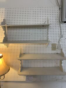Pair of white wall shelves