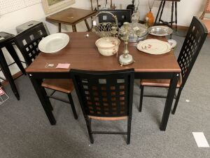 Modern table with 4 chairs. Chair backs and table frame are metal