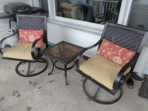 (2) swivel lawn chairs and table
