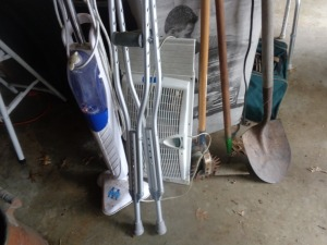 Floor scrubber, window fan, crutches, and assorted garden tools