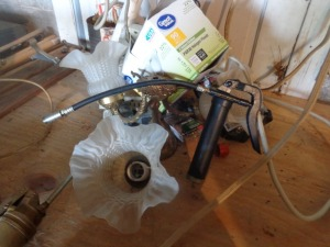 Small grease gun, power strip, light fixture