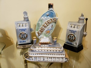 (4) Vintage Liquor Bottles - Las Vegas, Reno, And River Queen