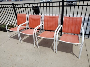 (4) White/Orange Outdoor Chairs