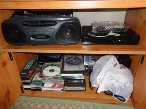 Cassette tape player w/ cassettes and DVD player w/ DVD's
