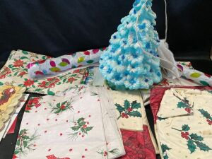 Vinyl Tablecloths and Lighted Ceramic Christmas Tree in Tote