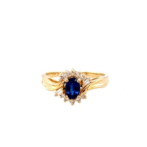 Saphire and Diamond Ring. 14k yellow gold with .5 carat saphire and ten round diamonds weighing a combined .14 carats.