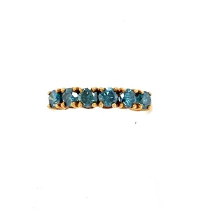 Blue diamond ring. Yellow gold ring with six round color treated blue diamonds with a combined weight of 1 carats.