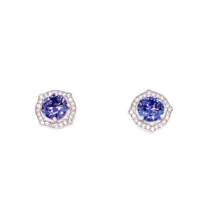 .925 Silver Rosette with Large Tanzanite Colored Center CZ and Triple A Quality Clear CZ's