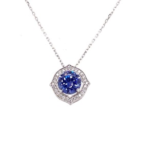 .925 Silver Rosette with Large Tanzanite Colored Center CZ and a Triple A Quality CZ's
