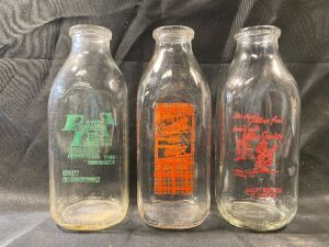 THREE DAIRY BOTTLES