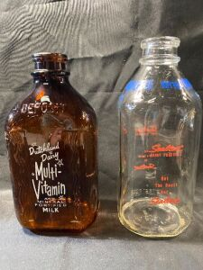 TWO DAIRY BOTTLES