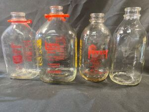 FOUR DAIRY BOTTLES