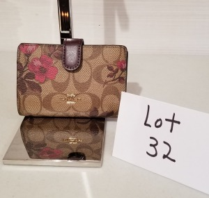Signature print wallet by Coach