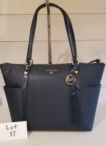 Nomad large zip top tote by Michael Kors