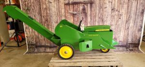 Customized Ertl John Deere Model 20 pedal tractor w/mounted No. 237 corn picker