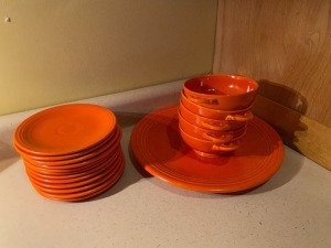 Fiesta-ware saucers, bowls, and plate