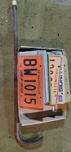 Several vintage License plates  and old Walking Cane