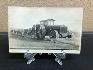 Pioneer tractor hauling wagons postcard