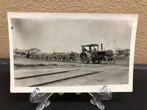 Rumely Gas Pull tractor pulling wagons postcard
