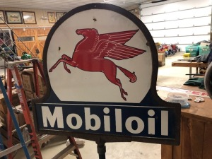 Mobiloil curb sign with gargoyle base