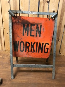 Men Working Stand Sign