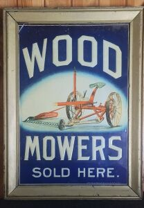 Wood Mowers Sold Here framed embossed colored tin litho