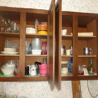 Contents of (2) upper kitchen cupboards including dishware, Tupperware, small scale, much more